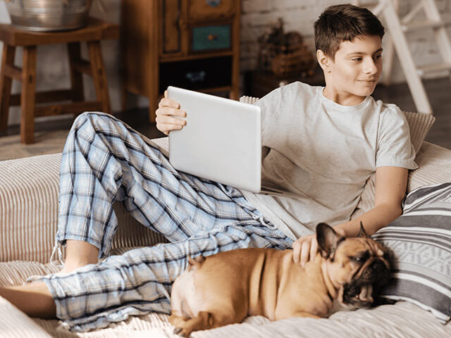 Boy on couch with his dog