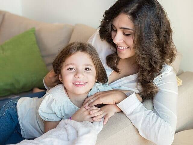 Mom and daughter playing on couch