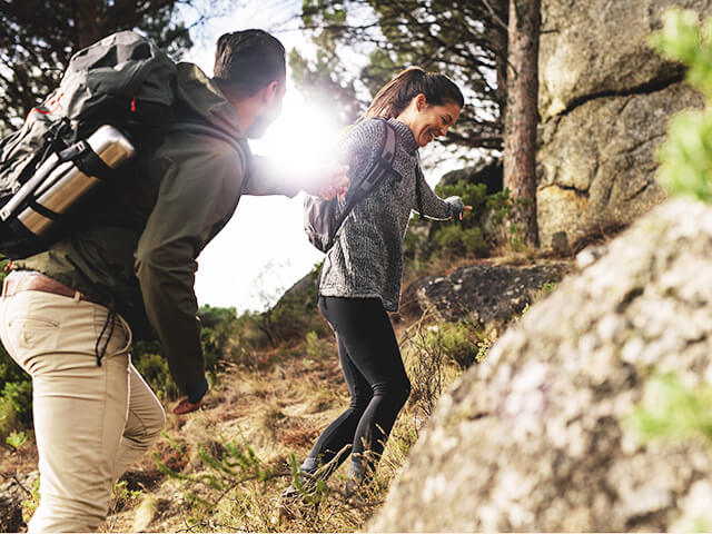 Young couple hikes outside
